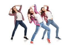Three young women dancing over white background Stock Images