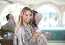 Three young women drinking tea at spa resort Stock Photography