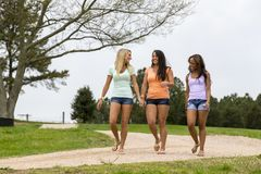 3 Girlfriends Enjoying A Day At The Park Before Heading To Class royalty free stock photos