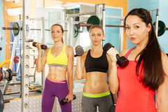Three young women in the fitness club Stock Image