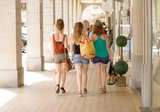 Three young women go shopping Stock Photos