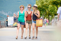 Three young women go shopping Royalty Free Stock Photography
