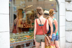 Three young women go shopping Royalty Free Stock Photo