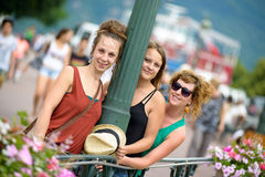 Three young women go shopping Stock Images