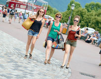 Three young women go shopping Stock Photography