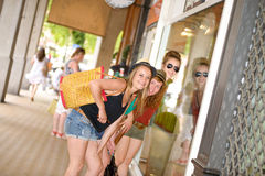Three young women go shopping Royalty Free Stock Images