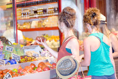 Three young women go shopping Stock Photos