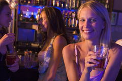 Three young women have drinks Stock Photos