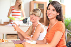 Three young women having breakfast Stock Image