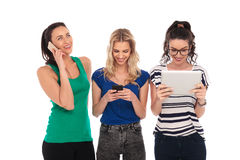 Three young women having fun communicating Stock Images