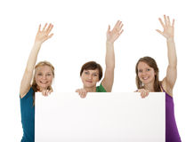 Three Young Women Holding A Banner And Greeting Royalty Free Stock Photo