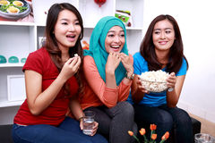 Three young women look excited when watching a movie Royalty Free Stock Images