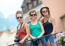 Three young women make tourism in Annecy Royalty Free Stock Photography