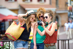 Three young women make tourism in Annecy Royalty Free Stock Image