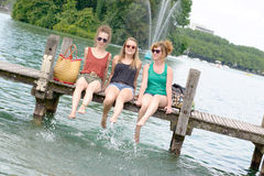 Three young women make tourism in Annecy Royalty Free Stock Photos
