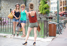 Three young women make tourism in Annecy Stock Image