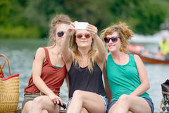 Three young women make tourism Royalty Free Stock Photo