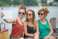 Three young women make tourism Stock Image
