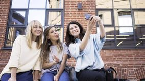 Three young women making faces and taking a selfie on a summer day stock video footage