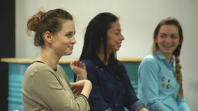 Three young women at the psychological training stock video footage