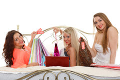 Three young women with purchases. Shopping. Stock Images