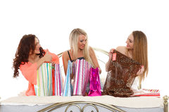 Three young women with purchases. Shopping. Royalty Free Stock Photo