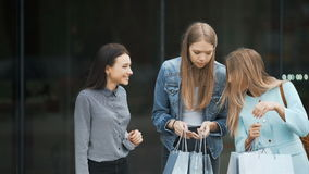 Three young women sharing their new purchases with each other