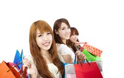 Three young women with shopping bag Stock Photography