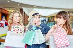 Three young women shopping stock images
