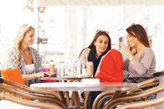 Three young women after shopping at coffee Stock Image