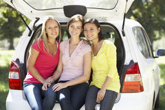 Three Young Women Sitting In Trunk Of Car Royalty Free Stock Images
