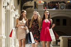 Three Young women with some shopping bags in the mall Royalty Free Stock Images