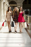 Three Young women with some shopping bags in the mall Stock Photography