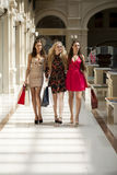 Three Young women with some shopping bags in the mall Stock Photo