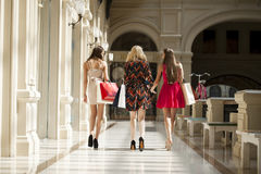 Three Young women with some shopping bags in the mall Royalty Free Stock Image