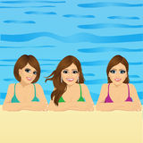 Three young women in swimming pool Royalty Free Stock Photo
