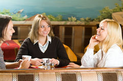 Three young women talking Stock Image
