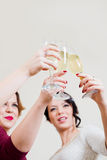 Three young women toasting with champagne Royalty Free Stock Image