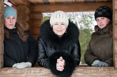 Three young women in winter clothes Stock Photography