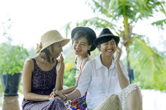 Three of younger asian woman friend talking and laughing happine Royalty Free Stock Photo