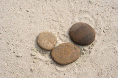Three zen stones with copy space lying on the beach Royalty Free Stock Images