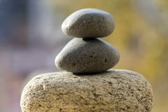 Three zen stones pile, white and grey meditation pebbles tower. Daylight royalty free stock photos