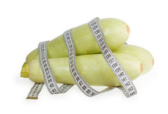 Three zucchini with white measuring tape Stock Images