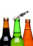 Threee bottles of beer and a opener Stock Photo