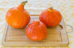 Three red pumpkins Stock Photography