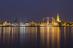 Threemasters in Antwerp by night. Antwerp Tall Ships Race, two three-master ships are moored at the river Scheldt, with the cityscape of the city of Antwerp in Royalty Free Stock Photography