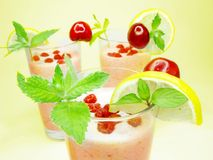 Threen fruit cocktails with lemon and cherry Stock Images