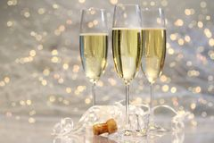 Threes glasses of champagne. With silver background Stock Photography