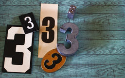 Threes. Scattered objects with the number 3 on it against blue background Royalty Free Stock Images