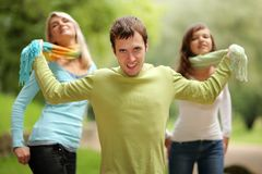 Threesome. Young man playing with two girls Stock Image